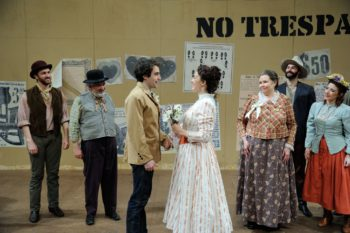 Charlie Thurston as Curly and Rachael Warren as Laurey (center) Photo by Mark Turek