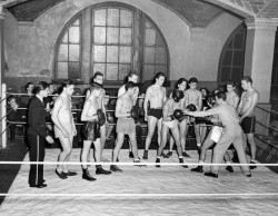 1940s Young Men Learning To Box